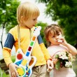 Boy and girl in the park — Stock Photo #1535391