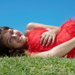 Girl lies on the gras — Stock Photo