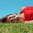 Stock Photo: Girl lies on the grass