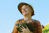 Women with flowers — Stock Photo