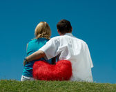 Man and a woman sitting on the grass — Stock Photo