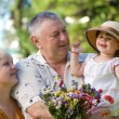 Little girl with grandfathers in the park — Stock Photo #1550270