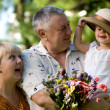 Little girl with grandfathers — Stock Photo