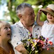 Stock Photo: Little girl with grandfathers