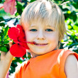Boy with the flower — Stock Photo