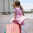 Stock Photo: Little girl with shopping bags