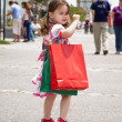 Little girl with shopping bags — Stock Photo #2634258