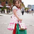 Little girl with shopping bags — Stock Photo #2634331