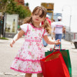 Little girl with shopping bags — Stock Photo #2634366