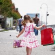 Little girl with shopping bags — Stock Photo #2634408