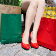 Stock Photo: Female legs and shopping bags