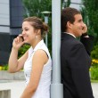 Guy and girl talking on a mobile phone — Stock Photo