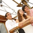 Three friends have good time on the sailboat — Stock Photo