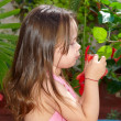 Little girl in a garden — Foto de Stock