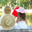 Boy and girl sitting in park — Stock Photo #2636553
