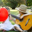 Stock Photo: Young couple with guitar