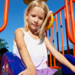 Girl riding on swing on playground — Foto Stock #2638354