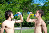 Guys drinking water — Foto Stock