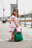 Little girl with shopping bags — Stock Photo