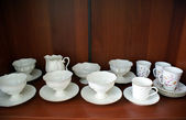 Cups in cupboard — Stock Photo