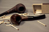 Tobacco pipes and matches — Stock Photo