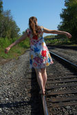 Woman advance on the railroad — Stock Photo