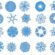 Blue snowflakes on a white background — Stock Photo