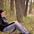 Reading book in forest — Stock Photo