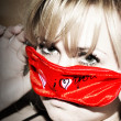 Blonda woman with red mask — Stock Photo