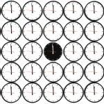 Many clocks on the white wall — Stock Photo #1506137