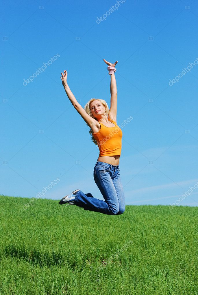 HAPPY YOUNG WOMAN JUMP ON THE MEADOW  Stock Photo #1523292