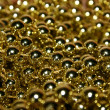 Gold beads — Stock Photo