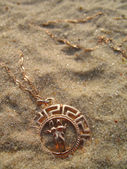 Medallion on sand. — Stock Photo