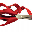 The scissors cutting a measuring tape. — Stock Photo #1624746