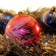 Three big spheres in a tinsel — Stock Photo