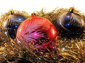 Three big spheres in a tinsel — Стоковое фото