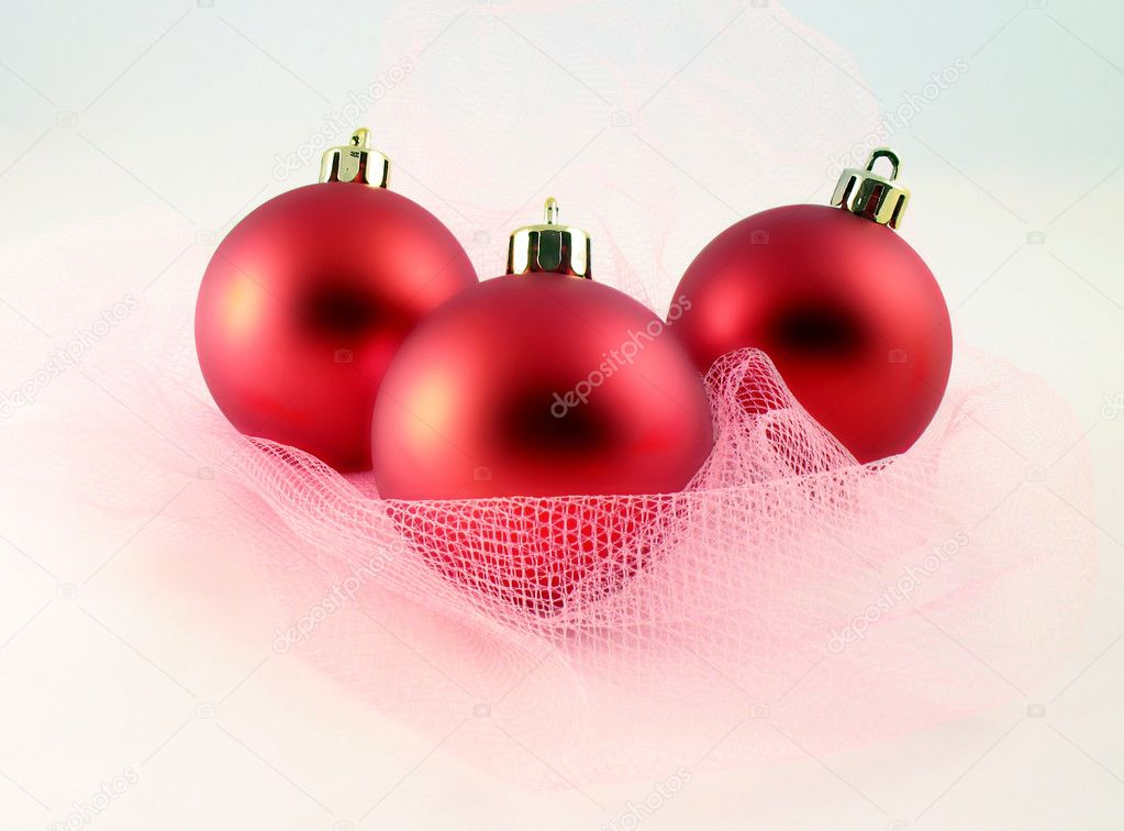 Decoration - three red spheres for Christmas tree with pink grid. It is on light background — Stock Photo #2002432
