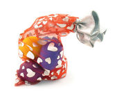 Easter eggs in bag with hearts on white — Stock Photo