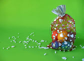 Easter eggs in bag and scattered beads — Stock Photo