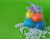 Easter eggs in small bag with beads — Stock Photo