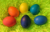 Six easter eggs on green shaggy carpet — Stock Photo