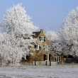 Gorgeous winter landscape with a farmhou — Stock Photo