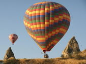 Hot air balloons above a gorgeous lands — Stock Photo