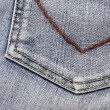Pocket of a blue jeans - Stock Photo