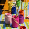Different kinds of paint for a child - Stock Photo