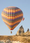 Hot air balloon above a landscape — Stock Photo