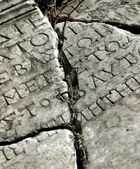 Ancient stone with latin inscription — Stock Photo