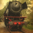 Grunge image of a old steamtrain — Stock Photo