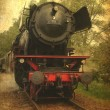 Grunge image of a old steamtrain - Stock Photo