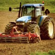 Stock Photo: Grunge image of tractor on farmland
